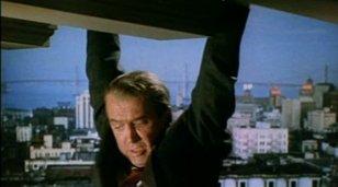Vertigo_1958_trailer_Stewart_hanging_on